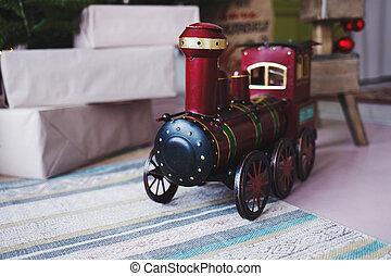 toy vintage steam locomotive on the floor