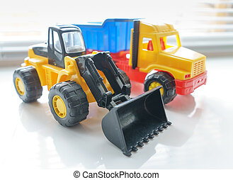 Toy Wheel Loader and Toy Dump Truck Close up, Toy Industrial Vehicle, Plastic Wheel Loader Excavator for Earth Moving Works at Construction Site, Miniature Earth Mover, Backhoe Loader