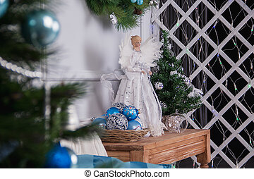 Toy white angel and Christmas tree