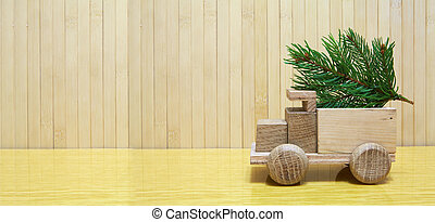 Toy wooden car and christmas tree