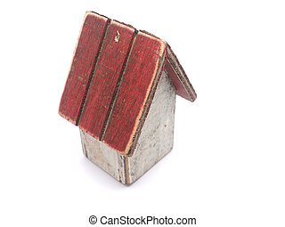 Toy wooden house on a white background