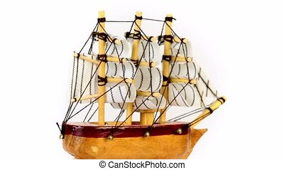 Toy wooden ship circling isolated