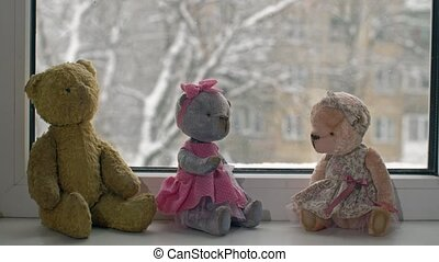 Toys and snow falls outside the window - Toys on the...