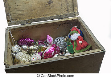 Toys for fir tree in old box on light background