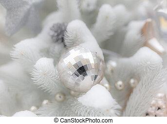 Toys on a white Christmas tree