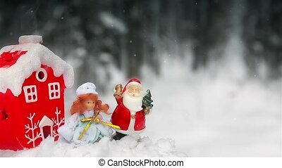 Toys Santa Claus and snow maiden in the forest in the open air near the Christmas tree 1920 HD
