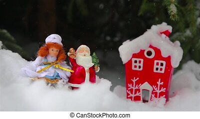 Toys Santa Claus and snow maiden in the forest outdoors