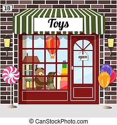 Toys shop facade of brown brick. Doll house, bear, balloon ...
