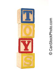 Toys - Wooden building blocks stacked vertically spelling...
