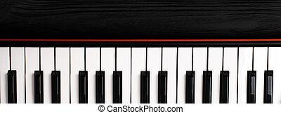 trä, synthesizer, svart fond, tangentbord
