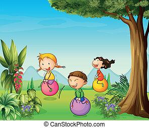 três, crianças, tendo divertimento, com, um, saltando bola