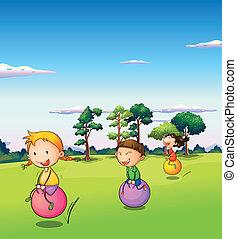 três, crianças, tocando, com, a, saltando bolas