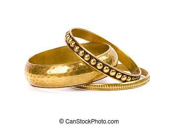 três, dourado, pulseiras