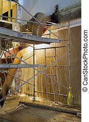 trabajador construcción, con, antorcha golpe, corte, acero
