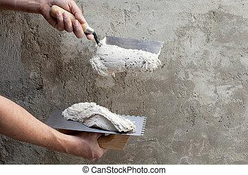 trabajador construcción, paleta, mellado, manos