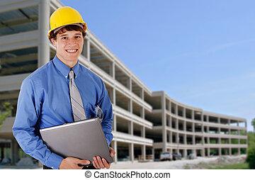 trabajador construcción, tenencia, computador portatil, delante de, un, construcción comercial, edificio