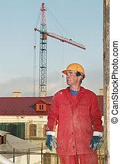 trabajador, constructor, en, interpretación el sitio