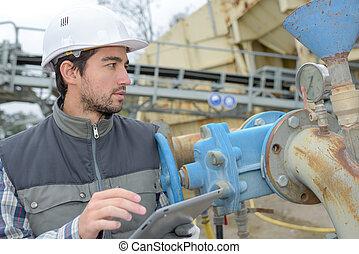trabajador industrial, tenencia, tableta