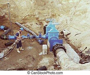trabajador, metro, para, reconstrucion, de, agua bebida, system., técnico, experto, en, puerta, válvula