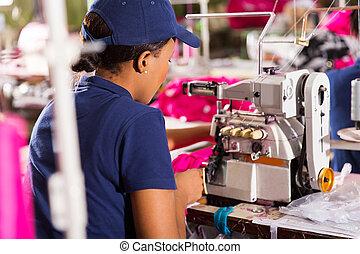 trabajador textil, vista trasera