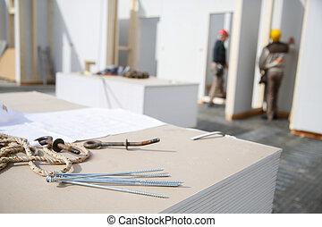 trabajadores, tornillos, cartón de yeso, paneles
