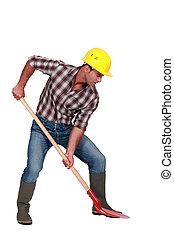 trabalhador, cavando, tiro estúdio