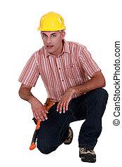 trabalhador construção, ajoelhando