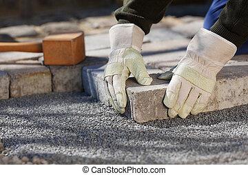 trabalhador construção, com, pavestone