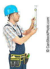 trabalhador, homem, medindo, com, bolha, nível