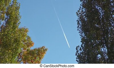 Trace of the plane in the blue sky.