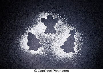 Traces from a stencil in the form of a Christmas tree and angel