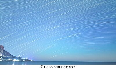 Traces from stars in the form of lines. Cape Sarich (Golden), the southernmost point of the Crimea. Time Lapse