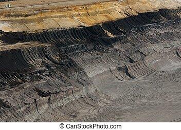 Traces of destructio - Traces of a bucket-wheel excavator in...