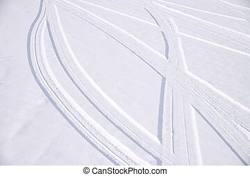 Traces of intersecting arcs of automobile tires in fresh...