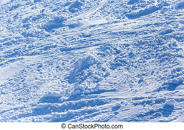 Traces of skiers on white snow in the mountains