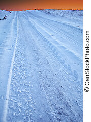 traces of the car wheels on a snowy road