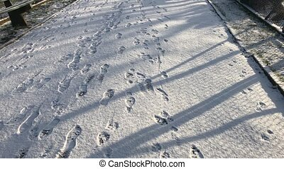 Traces on snow as you are walking