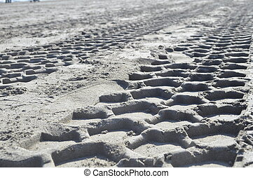 Traces on the sand - Traces of truck, tractor, on a white ...