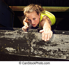 Traceur Climbing Industrial Wall - Determination on the face...