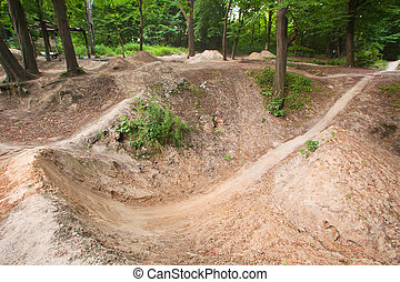 Track for dirt jumping on bikes at the forest