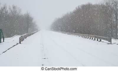 track road the winter is very heavy snow blizzard outdoors...