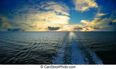 Track ship in the sea at sunset