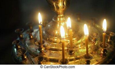 Track Shot of White Candles Burning
