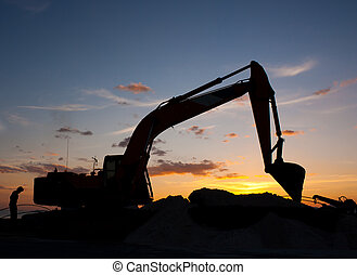 excavator machine doing earthmoving - track-type loader...