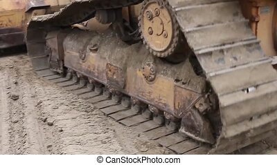 Track wheels of a heavy caterpillar - Detail on continuous...