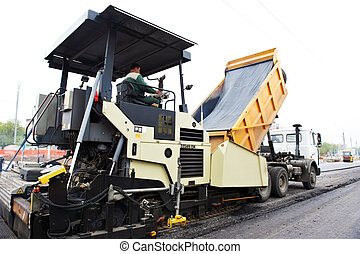 tracked paver at asphalt pavement works for road repairing