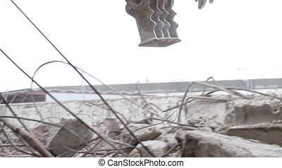 Tracked Excavator bite concrete debris