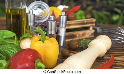 Tracking shot fresh vegetable background and seasoning for...