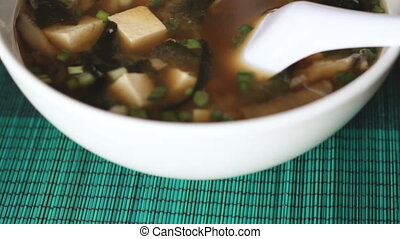 Tracking shot of miso soup bowl