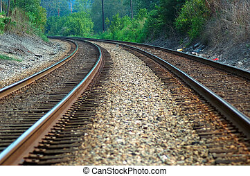 Tracking the Curve - Railroad train tracks curving around...